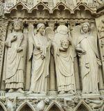 Барельефы над входом в Собор Парижской Богоматери
