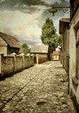 Узкая улочка старого города старый фанарь