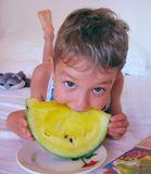 Ребёнок с арбузом.