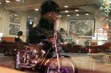 """Мы сидели в ресторанчике и ждали пока принесут еду. Я смотрела в окно, в котором отражался муж. Его отражение легло на """"мотоцикл"""". Мне показалось это символичным, ведь он не мыслит себя без Харли.  Но снимок не только про """"байкера и его мотоцикл"""", он еще и про ту и эту сторону окна.  Фиолетовый оттенок на мотоцикле  - неон вывески отражается. Сплошные отражения :)"""