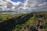 Сухопутная граница между Америкой и Европой проходит в Исландии в виде разлома между 2 одноименными тектоническими плитами ,который прдолжается на север и на юг по океану.Разлом периодически страдает отрыжками ,которые мы тоже ощущаем.А вообще какое сладкое слово отпуск.Наконец он наступил...Желаю вам творческих успехов и хорошего настроения!