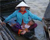 Продолжение серии о камбожийцах, живущих в плавучих домах на озере Тонлесап. Вся серия - здесь: http://www.lensart.ru/album-uid-5e-aid-503c-sh-1.htm