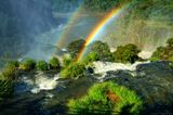 """Водопады Игуасу - настоящее чудо света. В переводе с языка гуарани это название означает """"большая вода"""". Разбиваясь о скалы, потоки воды образуют множество водяных брызг, которые, преломляясь в лучах солнца, превращаются в многочисленные радуги.Посмотреть кадр на весь экран можно на моём сайте:  http://serge-photo.ru/serge.htm#/Argentina"""