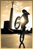 На велосипеде (точнее над ним) Кирилл.Выдержка 1/2000.