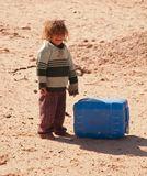 девочка из селения бедуинов на границе Египта с Иорданией. чудовищная нищета и антисанитария, но дети есть дети: счастливы и мелочам, таким как этот найденный бак, который можно тоже приспособить для игр