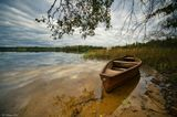landscape lake water boat sky clouds afternoon autumn Latvia