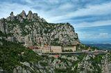 Монастырь, расположившийся на высоте 725 м над уровнем моря, получил своё название по горной местности Монсеррат («Разрезанные горы») в 50 км к северо-западу от Барселоны, где на небольшом пространстве в 10 х 5 км высятся тысячи известняковых скал причудливой формы. Человеческая фантазия дала отдельным скалам столь же занимательные имена: Мумия, Брюхо епископа, Хобот слона, Лошадь Бернарда.
