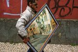 Just an occasional shot of man carrying a mirror near flea market in Lisbon.