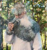 Белый мох настоящий, собран в северных лесах и будучи мокрым нашивался на накидку и использовался для головного убора. Костюм сшит в ручную. Дым - не фотошоп! :) Еще и не такое встретишь в наших северных лесах!