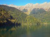 В живописных горах на высоте 950 м. над уровнем моря уютно расположилась жемчужина Абхазии - озеро Рица. Это горное озеро ледниково-тектонического происхождения, окруженное со всех сторон горами, поросшими густыми лесами. И захватывающая дорога, ведущая к озеру, и чарующие виды самого озера и окружающих его величественных и манящих гор делают этот удивительный уголок природы местом, в которое хочется вернуться еще не раз ...