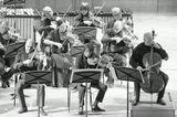 «на троих» - концерт для скрипки, альта, виолончели и струнных с фортепиано Альфреда Шнитке.