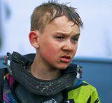 Жанровый портрет юного мотогонщика после финиша