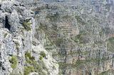 Начинающий турист-альпинист в горах Южной Африки